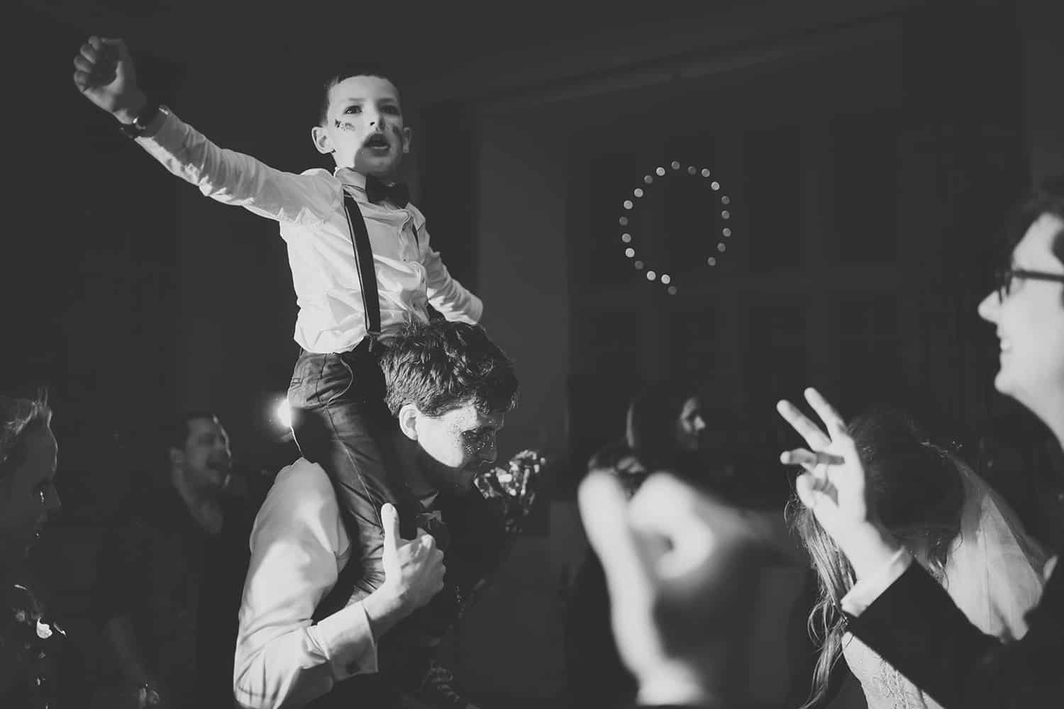 boy on shoulders at a wedding in monmouth
