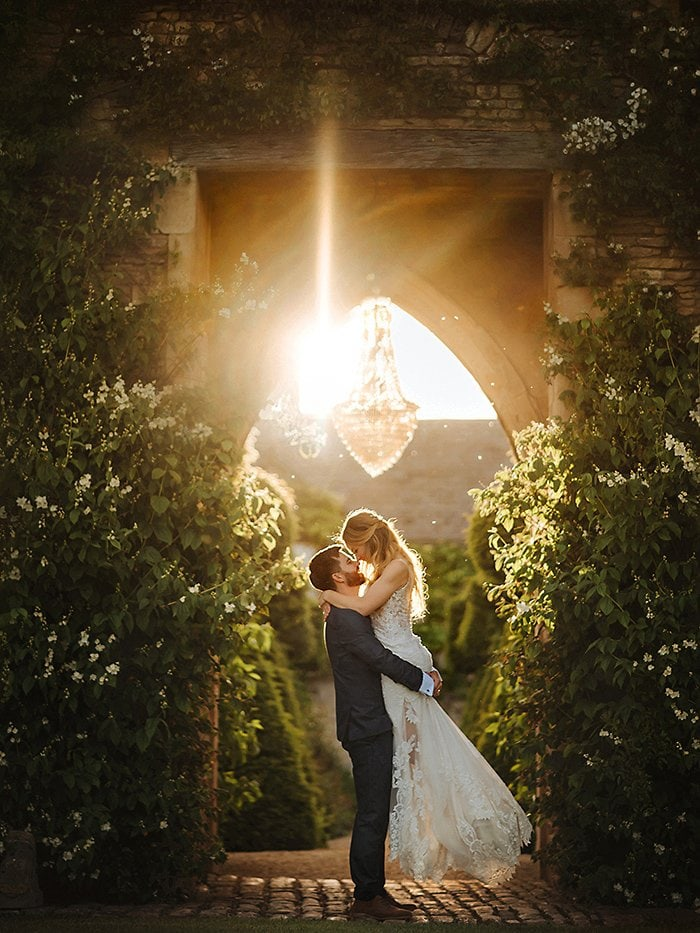 Couple kissing at sunset at the lost orangery